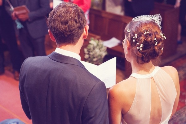 Bride and groomr eading in church