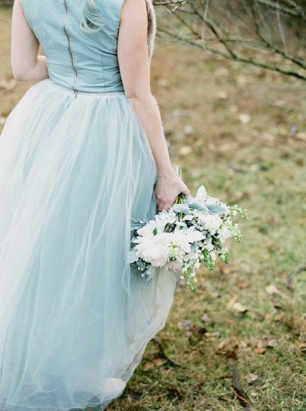 Bride walking holding winter wedding bouquet