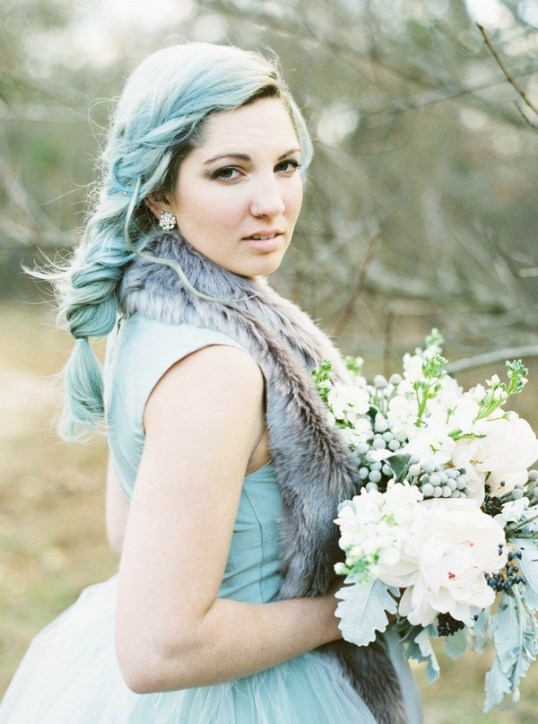 Bride with blue hair looking at camera