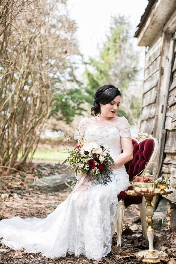 Bride sitting on chair in woods