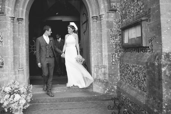 Bride and groom at door of church
