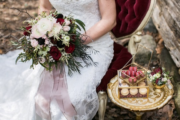 Bride sitting holding bouquet