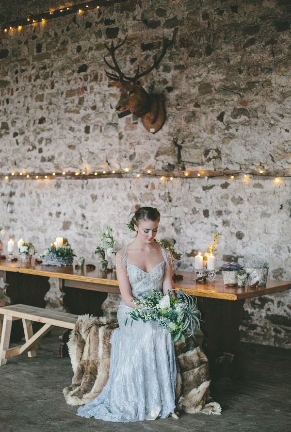 Bride sitting on bench at table