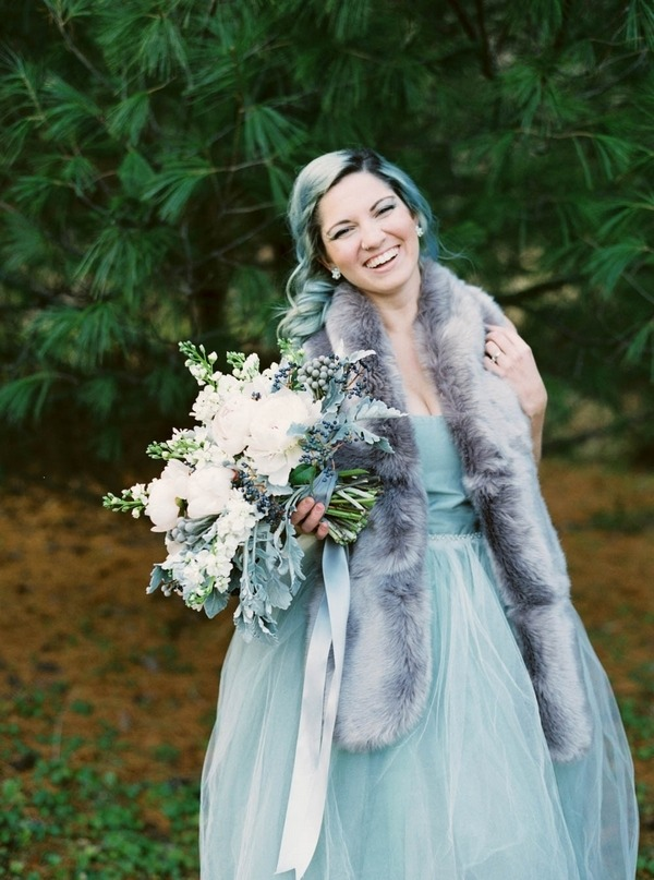 Bride with blue hair smiling