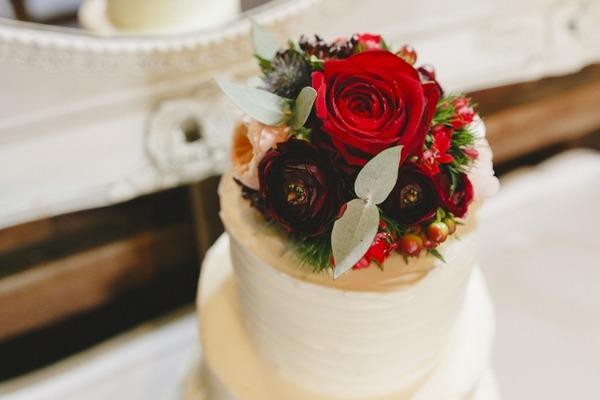 Floral cake topper on winter wedding cake