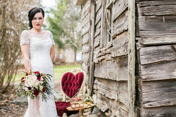 Bride standing next to red chair