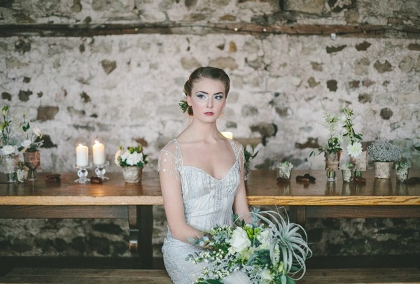 Bride sitting at table with bouquet