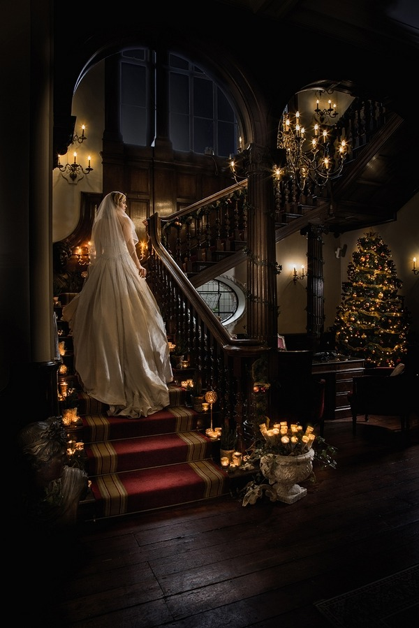 Bride walking up staircase at Wyck Hill House