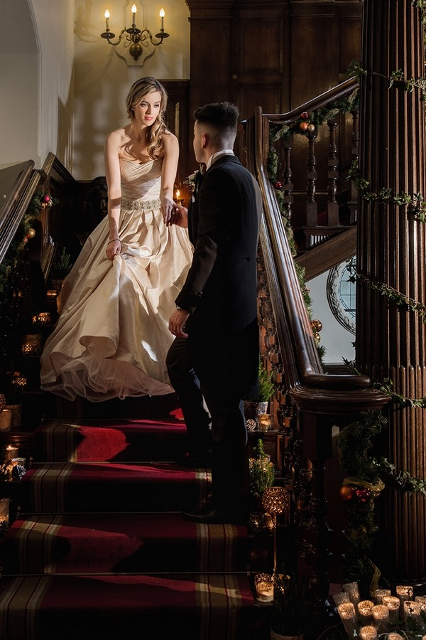 Bride and groom standing on stairs at Wyck Hill House