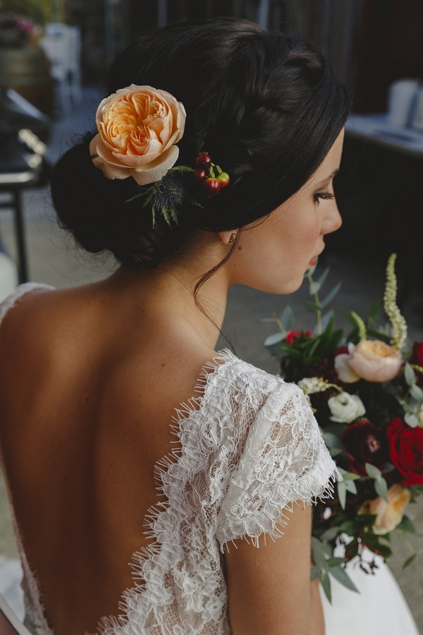 Peach flower in bride's hair