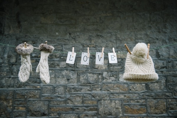 Hat, gloves and LOVE cards pegged to clothes line