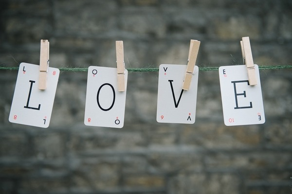 LOVE playing cards pegged to clothes line