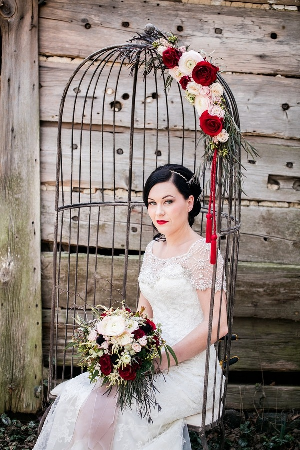 Bride sitting in birdcage swing chair