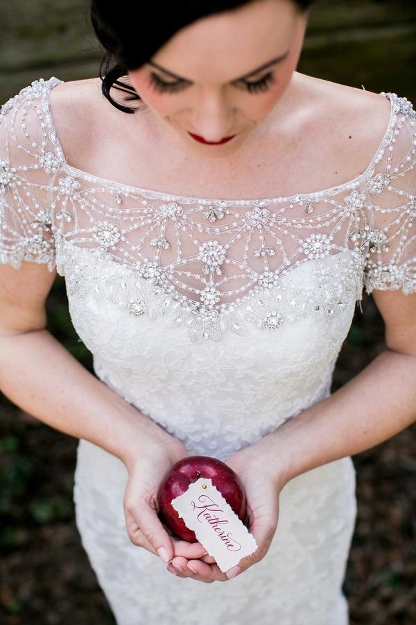 Bride holding apple