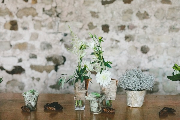 Pots and votives with winter foliage