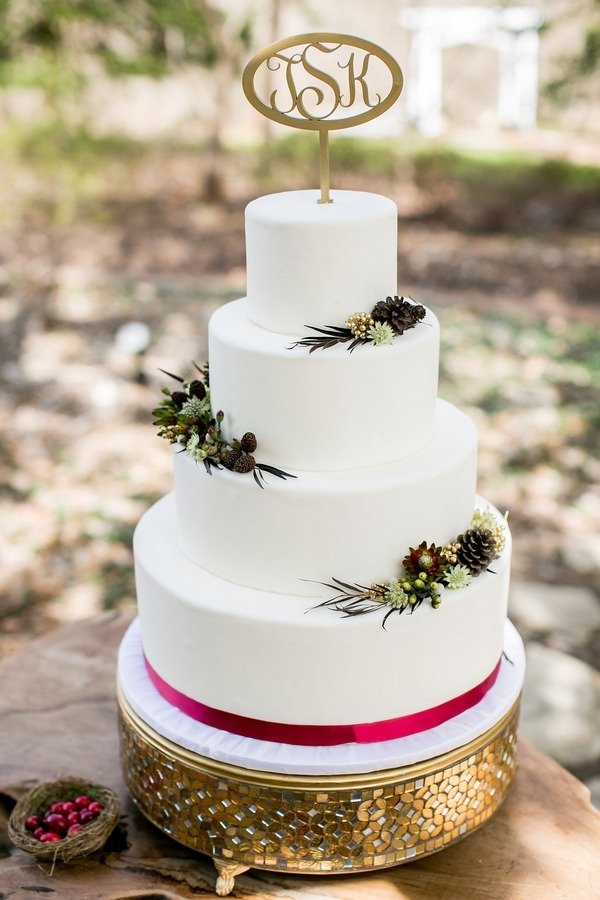 Winter wedding cake with red ribbon