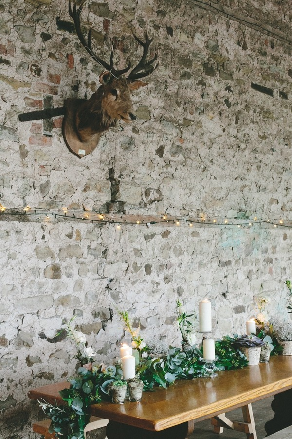Stag head on wall above wedding table