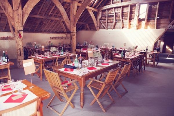 Wedding tables in barn at West Stoke Farm wedding
