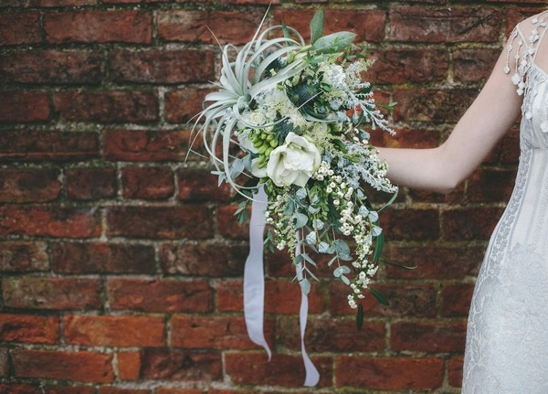 Bride holding out winter bouquet