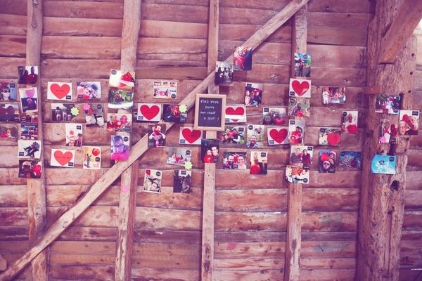 Family photos on barn wall