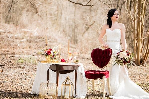Bride standing behind chair