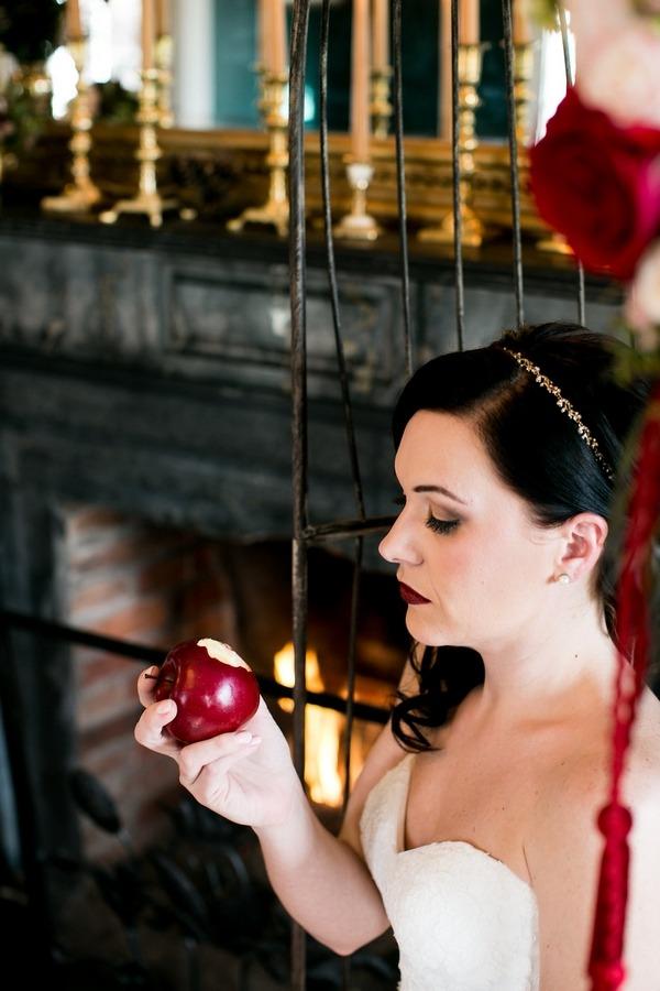 Snow White bride taking bite of apple