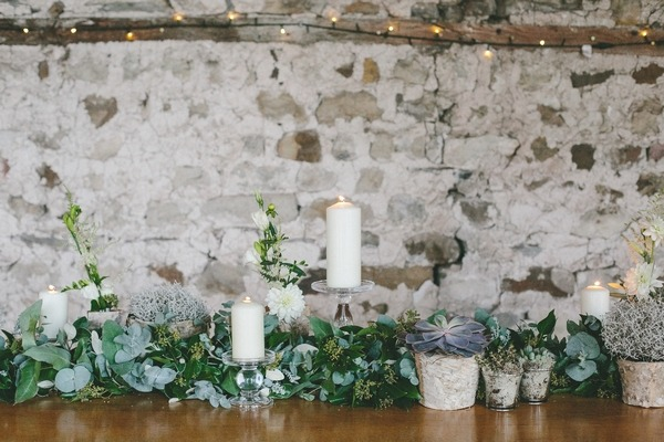 Foliage and candles on wedding table