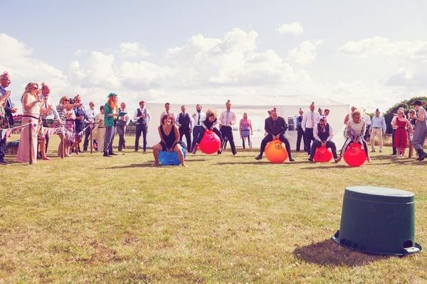 Space hopper race at West Stoke Farm wedding