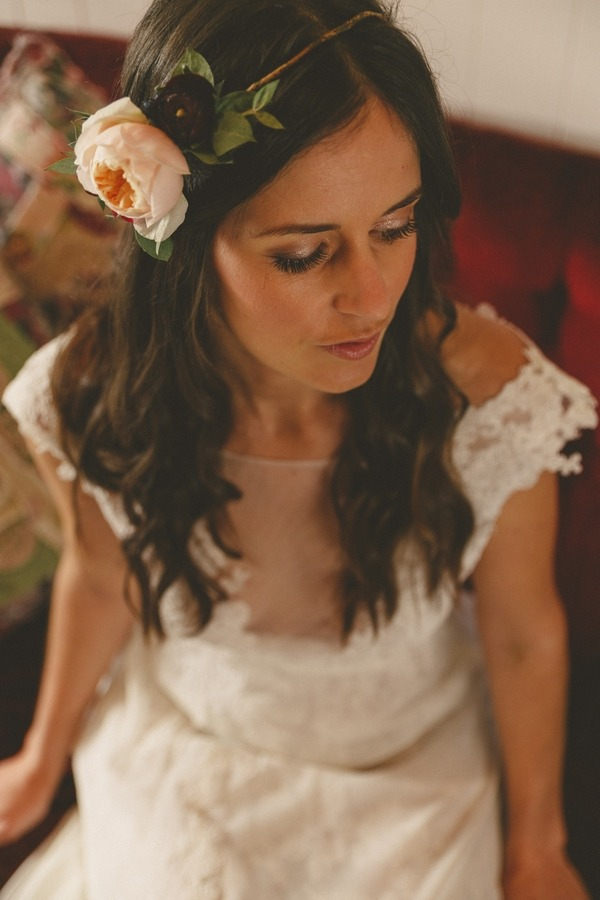 Bride sitting wearing floral headband