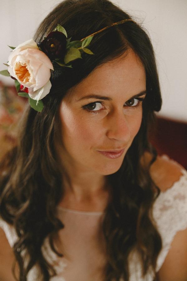 Bride with floral headband gazing at camera