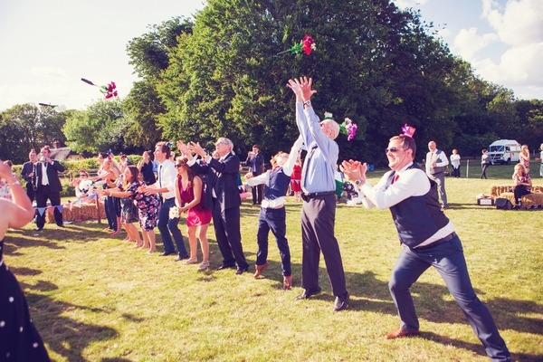 Bouquet catching game at West Stoke Farm wedding