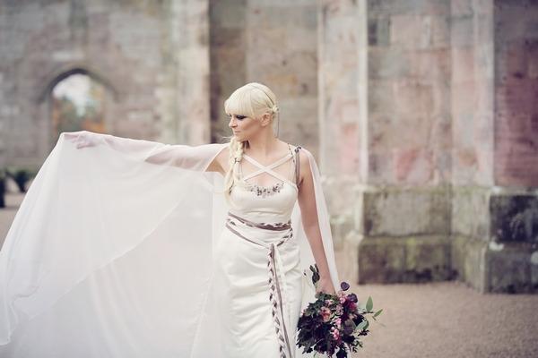Bride holding out bridal cape