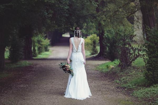 Back of bride standing on lane