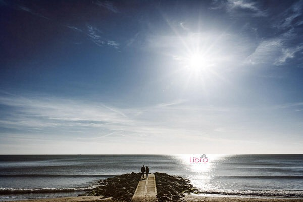 Couple looking out to sea from Branksome Beach
