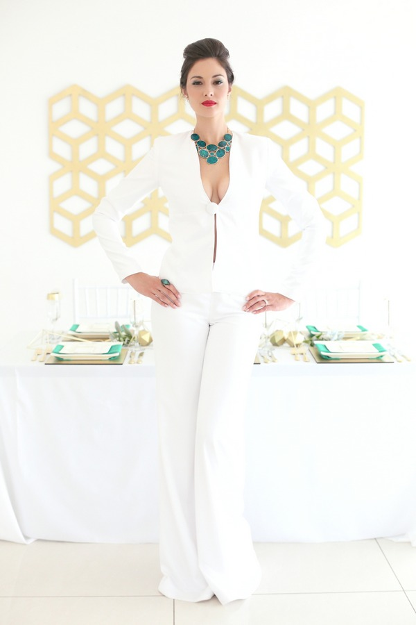 Bride wearing white bridal trouser suit