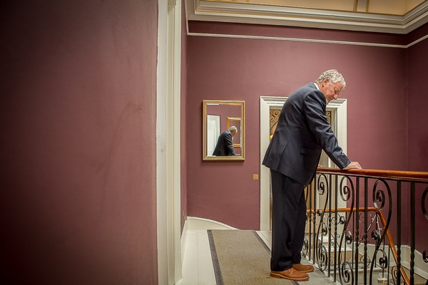 Father waiting for bride at top of stairs