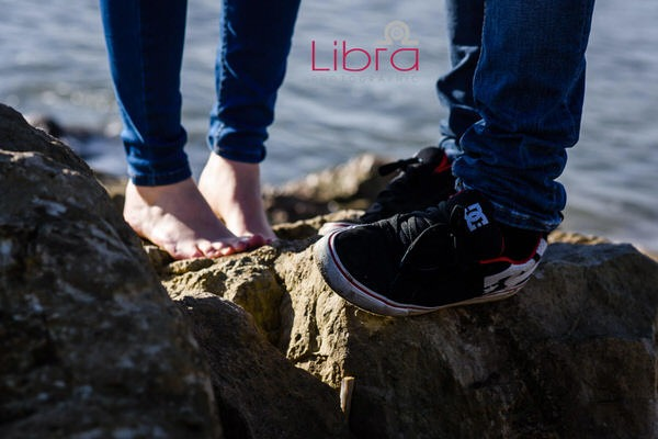 Couple's feet on rocks