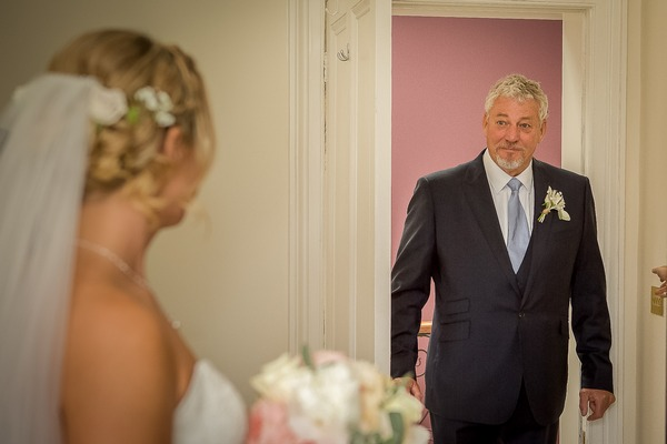 Father seeing daughter for first time on wedding day