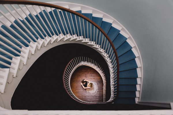 Bride and groom at bottom of spiral staircase - Picture by Murray Clarke