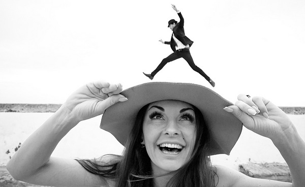 Groom appearing to jump over woman with hat - Picture by Emin Kuliyev
