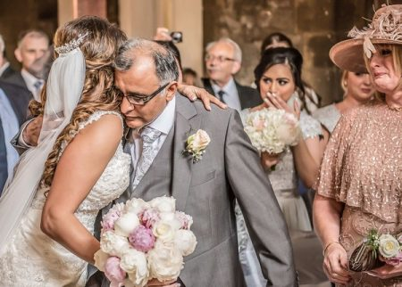 Bride hugging father at altar - Picture by Peter Anslow Photography