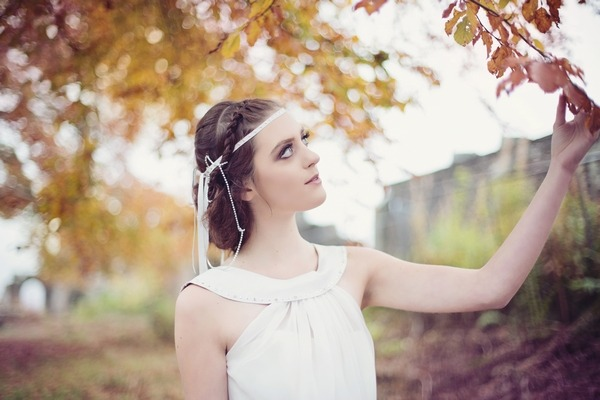 Bride with updo hairstyle with braid