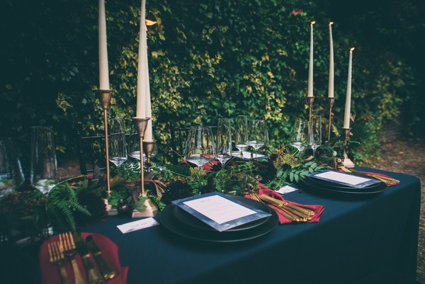 Wedding place setting with dark wedding styling