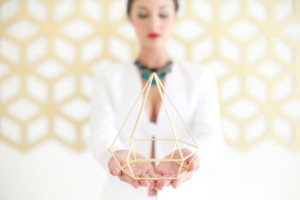 Bride holding geometric shape