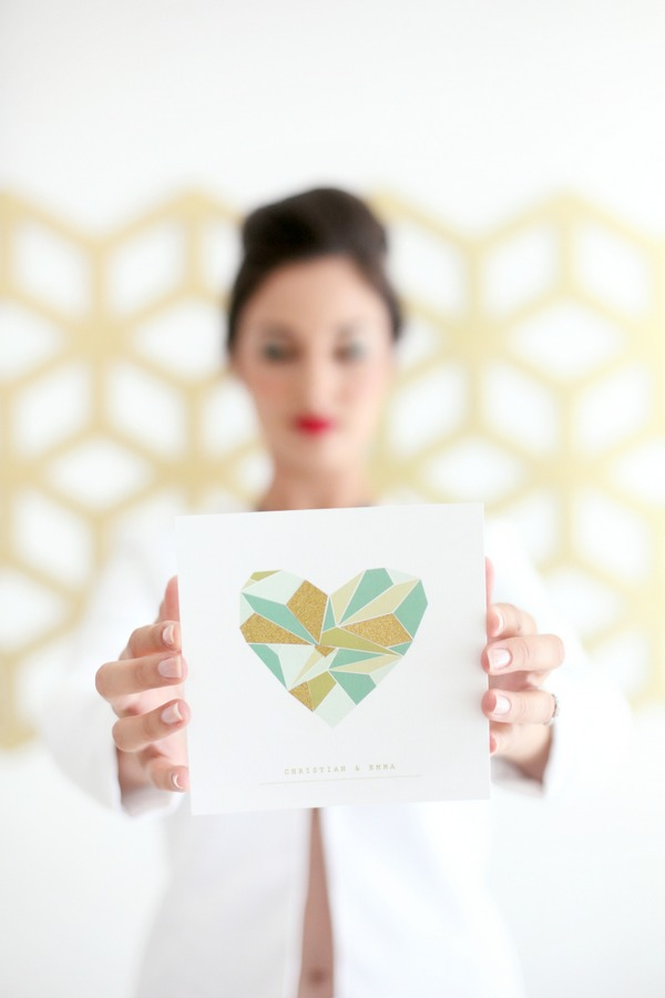 Bride holding geometric wedding invitation