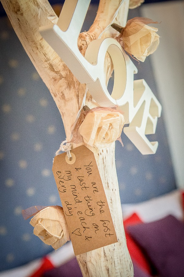 Message hanging from LOVE sign