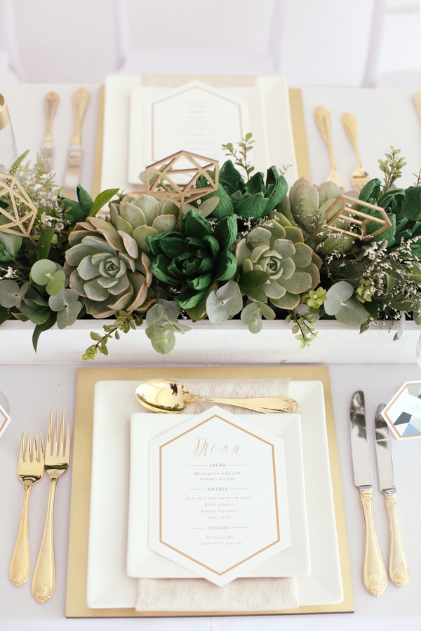 Wedding place setting with succulents centrepiece
