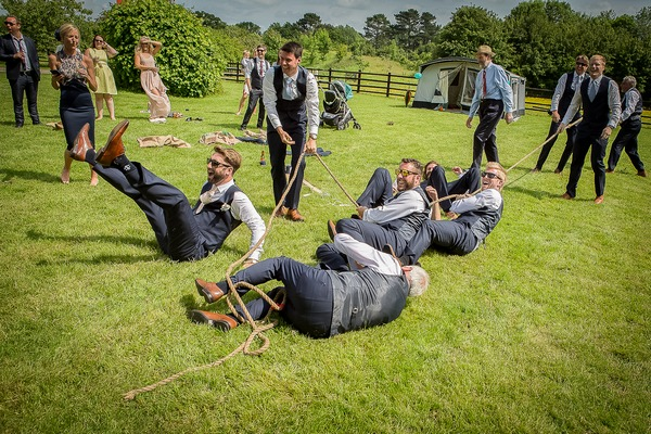 Tug of war team falling over