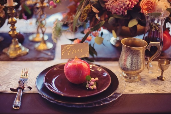 Wedding place setting with dark coloured styling