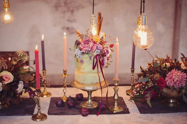 Wedding cake surrounded by candles